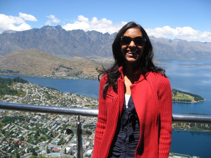 women standing with Queenstown, New Zealand in the background